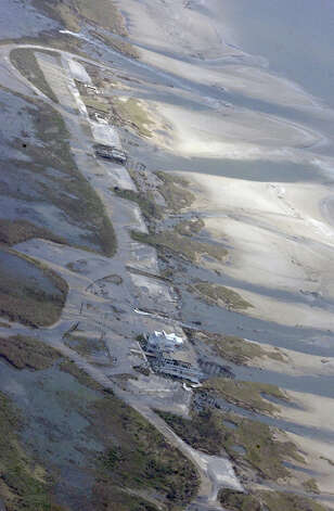 An airborne view of the beach near Sea Rim State Park shows storm surge waters still draining.  Park officials say the park, which has not been open since Hurricane Rita, experienced catastrophic damages from Ike. Dave Ryan