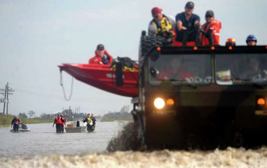Rescue personnel return from a search and recovery mission  where they saved two dogs in Sabine Pass