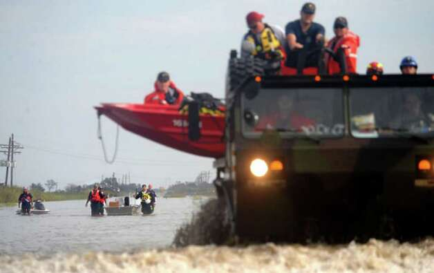 Rescue personnel return from a search and recovery mission  where they saved two dogs in Sabine Pass. Tammy McKinley