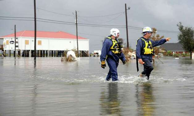 Rescue  workers  search for residents in Sabine Pass. Tammy McKinley
