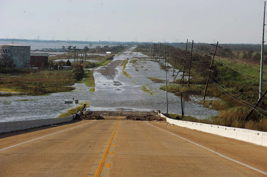 Surge waters flood Texas 87, leaving access to Sabine Pass still impossible two days after the storm hit.  Guiseppe Barranco