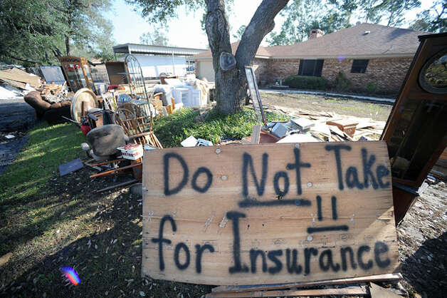 Many residents placed signs in their yards to protect their damaged items until insurance company representatives could view and catalog them. Guiseppe Barranco
