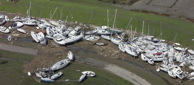 Ike's storm surge floated more than 200 boats inland, splintering many like matchsticks along the shore near the Pleasure Island Yacht Club. Dave Ryan
