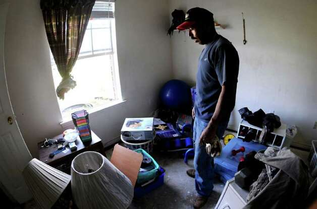 Wind-driven rain breached the windows of Harmon Lopez's home, soaking the carpet.  Tammy McKinley