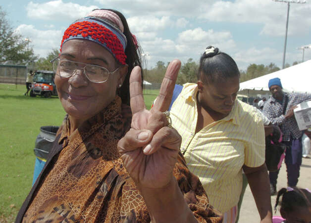 Eartha Sneed, 66, was happy to return to Beaumont after being evacuated to Tyler. She was on the first bus to arrive back at Beaumont Munical Athletic Complex. Pete Churton