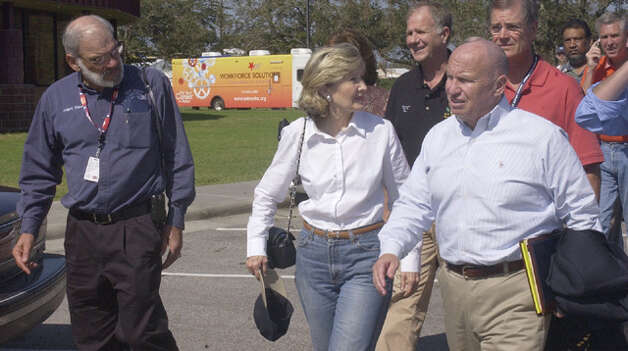 U.S. Sen. Kay Bailey Hutchison arrives after touring the Bridge City area with Orange County Judge Carl Thibodeaux, left,  U.S. Rep. Ted Poe, center,  U.S. Rep. Kevin Brady, right,  and other elected officials participating in a press conference at the Bridge City High School.  Dave Ryan