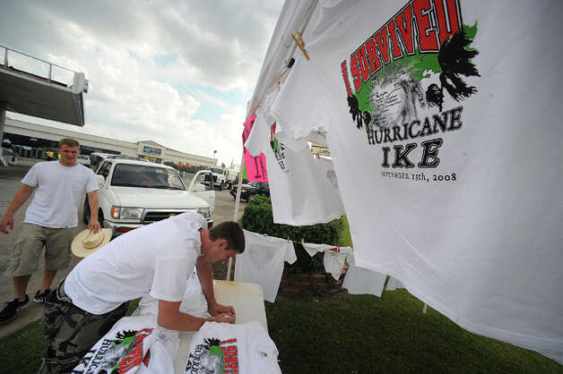 From left, Justin Becker and Derek Wilson sell Hurricane Ike survival T-shirts at a gas station on Interstate 10. Guiseppe Barranco