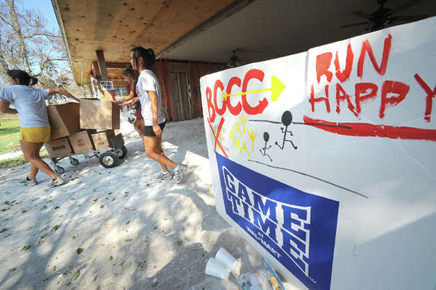 Bridge City High School cross country runners help during clean-up efforts at a flooded home. Guiseppe Barranco