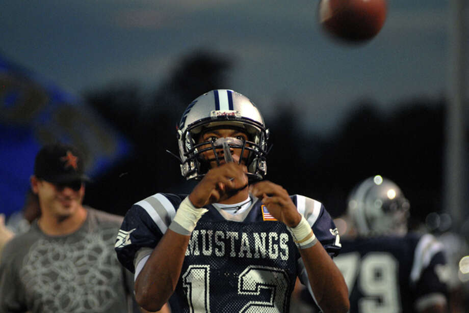 West Orange-Stark senior quarterback Reggie Garrett warms up before the start of Friday night's game against Jasper. Garrett was taken off the field on a stretcher in the second quarter of the game. He was pronounced dead at Memorial Hermann Baptist-Orange at 9:30 p.m., according to hospital spokeswoman Mary Poole. Beth Rankin/The Enterprise