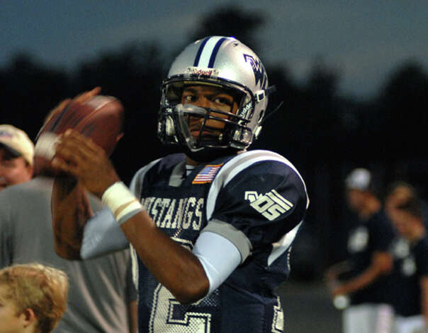 West Orange-Stark senior quarterback Reggie Garrett warms up before the start of Friday night's game against Jasper. Garrett was taken off the field on a stretcher in the second quarter of the game. Beth Rankin/The Enterprise