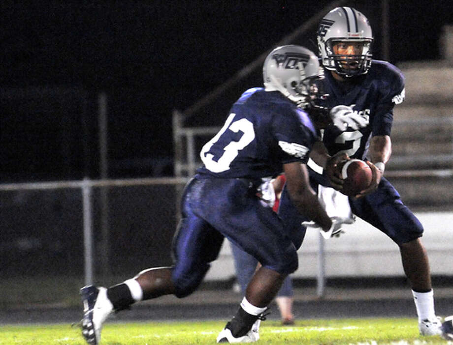 WO-S's Reggie Garrett fakes a hand off to DeCarlos Renfro during the game against Kirbyville at West Orange Stark High School in West Orange on Sept. 11, 2009. Tammy McKinley, The Enterprise