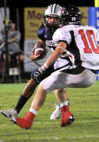 WO-S's Reggie Garrett tries to get around Kirbyville's Justin Keene at West Orange Stark High School in West Orange on Sept. 11, 2009. Tammy McKinley, The Enterprise / Beaumont
