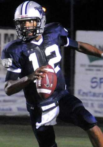 WO-S's Reggie Garrett looks to pass against Nederland at West Orange-Stark High School in West Orange on August 28, 2009.  Tammy McKinley, The Enterprise / Beaumont