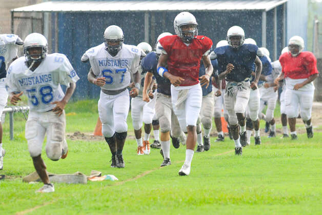 West Orange-Stark quarterback Reggie Garrett, center, jogs around the practice field with teammates before starting preseason football drills in August. Tuesday, August, 17, 2010 Valentino Mauricio/The Enterprise / Beaumont