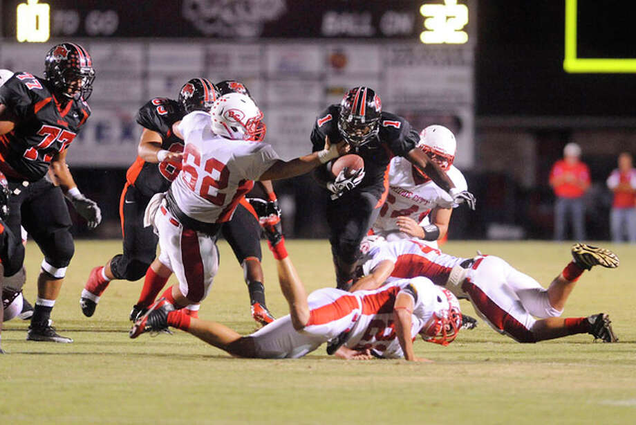 Kirbyville running back LeFredrick Ford rushes in the second quarter   against Bridge City at Kirbyville on Friday. Ford went on to break 4000 career rushing yards by the end of the first half and scrored two touchdowns.   September 17, 2010  Valentino Mauricio/The Enterprise