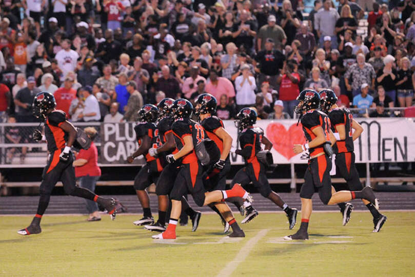 The Kirbyville Wildcats take the field for a homecoming game against The Bridge City Cardinals., Sep