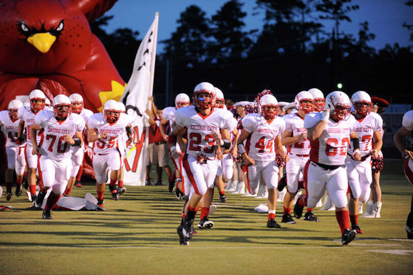 The Bridge City Cardinals take the field against Kirbyville Wildcats on Friday, September 17,2010. V