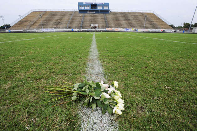 Twenty white roses were placed on the 50-yard line at the Mustangs' stadium Saturday in memory of quarterback Reggie Garrett, who collapsed on the sidelines and died during a game Friday night. Saturday, September 19, 2010  Valentino Mauricio/The Enterprise / Beaumont