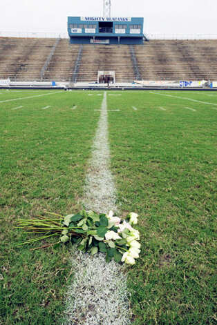 Twenty white roses were placed midfield on the 50-yard line at the Dan Hooks Stadium on Saturday in memory of quarterback Reggie Garrett, who collapsed on the sidelines and died during a game Friday night in West Orange, Texas.  Saturday, September 19, 2010 Valentino Mauricio/The Enterprise