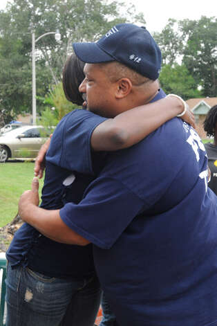 Reggie Garrett Sr., right, greets family and friends at his home who were there to offer condolences after his son, West Orange-Stark quarterback Reggie Garrett Jr., collapsed and died on the sidelines during Friday's game.  Saturday, September 19, 2010  Valentino Mauricio/The Enterprise / Beaumont