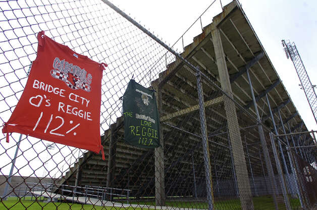 Jerseys with messages hang on the fence outside the Dan R Hooks football stadium Monday afternoon, where WO-S quarterback Reggie Garrett collapsed  Friday night during a game with Jasper.  These were from Bridge City and Little Cypress-Mauriciville.  Dave Ryan/The Enterprise