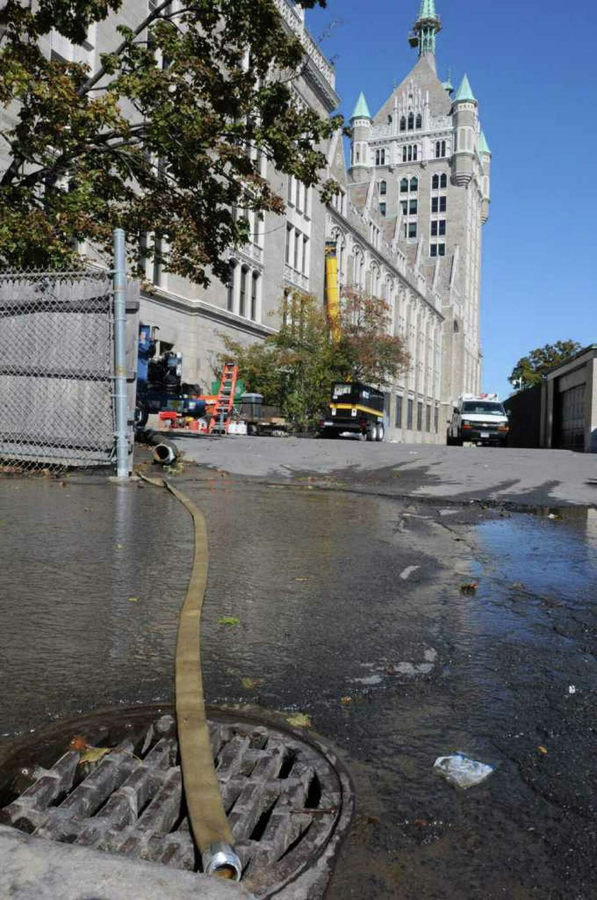 Water is pumped out of the SUNY headquarters building in Albany on October 12, 2010. Hundreds of workers have been told not to report to work because of a major water emergency that knocked out the power, computers and telephone systems. (Lori Van Buren / Times Union)