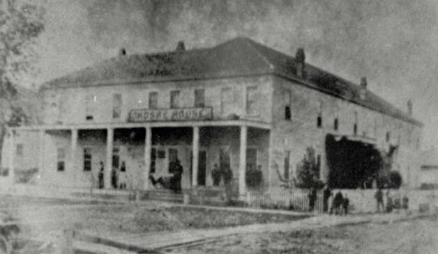 "BEAUMONT - The old Crosby House as it appeared in the early days of the Spindletop oil boom. ""It was built in 1880 by Col. A.F. Goodhue, great-grandfather of Johb B. Goodhue, and was a two-story frame building that was to become the center of all the oil promotions and activity during the discovery of oil at Spindletop in 1901."" - Beaumont Journal, 1976"