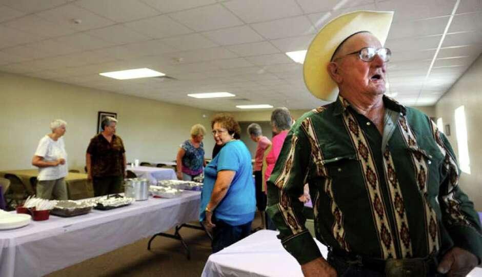 Jennings Eldridge chats with members of the Methodist Church before a pot luck community fellowship