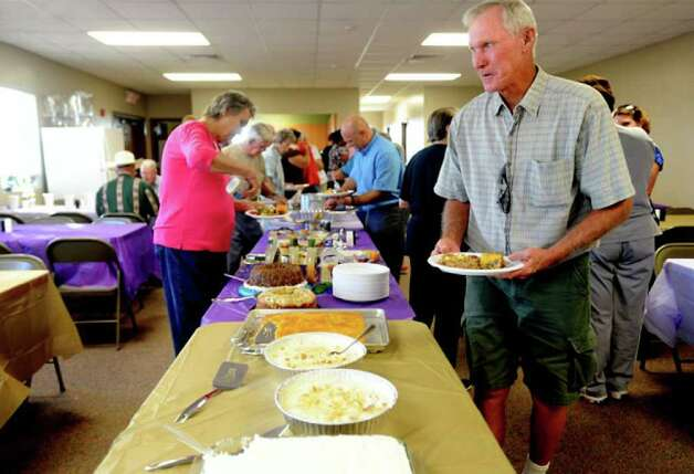 Members of the Sabine Pass community gather for a pot luck fellowship sponsored by the Methodist Church at the First Baptist Church in Sabine Pass, Tuesday. Before Hurricane Rita devastated the area, there were five churches in Sabine Pass. Since Hurricane Ike rolled through, only 2 remain. Several churches are sharing the First Baptist Church's facilities for fellowship and worship as they wait for their facilities to be rebuilt. Tammy McKinley/The Enterprise / Beaumont