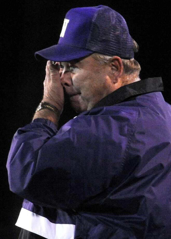 Newton's head coach Curtis Barbay watch his team take a healthy lead during the game against East Chambers at LC-M in Mauriceville, Friday. Tammy McKinley, The Enterprise