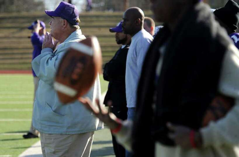 Newton's Athletic Director, Curtis Barbay watches from the sidelines as Newton plays against Dangerf