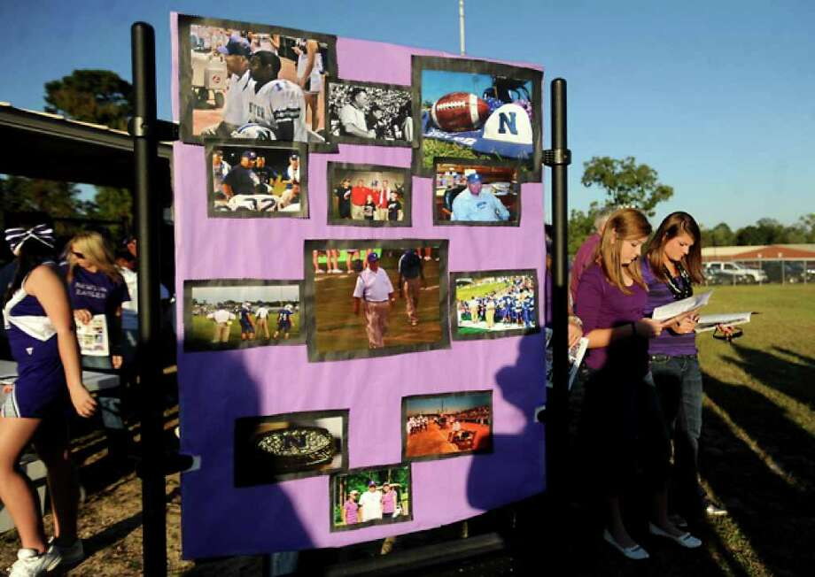 Hundreds of friends, family and fans gather together to honor the life and pay final respects to Coach Curtis Barbay during a public memorial service in his honor at Newton High School in Newton, Tuesday. Tammy McKinley/The Enterprise / Beaumont Enterprise