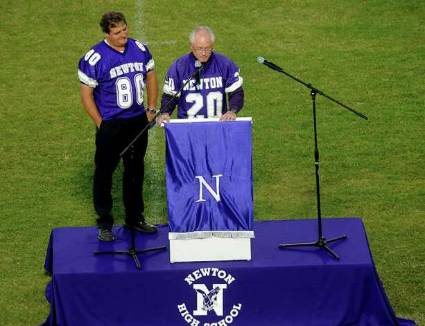 Donnie Meek and Eddie Hopkins from the 1974 state team offer rememberances as hundreds of friends, family and fans gather together to honor the life and pay final respects to Coach Curtis Barbay during a public memorial service in his honor at Newton High School in Newton, Tuesday. Tammy McKinley/The Enterprise / Beaumont Enterprise