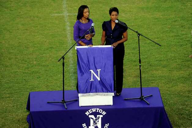 Lakeesha Kenebrew and Jamie Davis sing a rendition of On Eagles Wings as hundreds of friends, family and fans gather together to honor the life and pay final respects to Coach Curtis Barbay during a public memorial service in his honor at Newton High School in Newton, Tuesday. Tammy McKinley/The Enterprise / Beaumont Enterprise