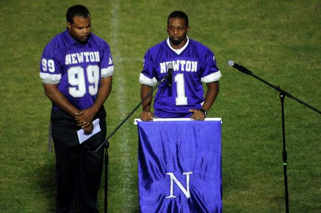 Tim Kenebrew and Rod Gulley of the 1998 state team offers rememberances as hundreds of friends, family and fans gather together to honor the life and pay final respects to Coach Curtis Barbay during a public memorial service in his honor at Newton High School in Newton, Tuesday. Tammy McKinley/The Enterprise / Beaumont Enterprise