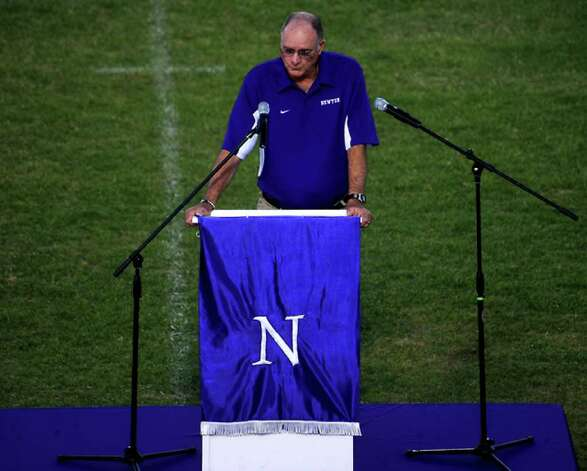 Lidney Thompson offers rememberances as hundreds of friends, family and fans gather together to honor the life and pay final respects to Coach Curtis Barbay during a public memorial service in his honor at Newton High School in Newton, Tuesday. Tammy McKinley/The Enterprise / Beaumont Enterprise