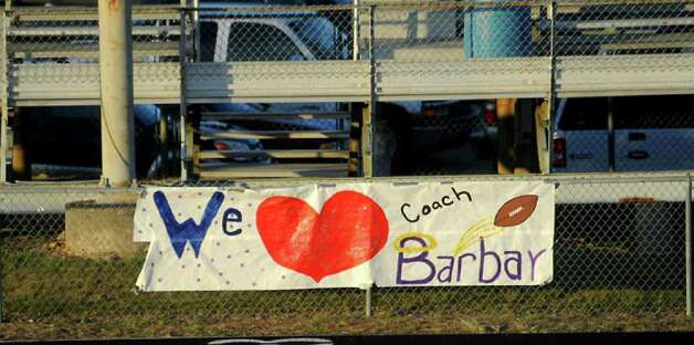 A sign showing support hangs on the visitors side fence as hundreds of friends, family and fans gather together to honor the life and pay final respects to Coach Curtis Barbay during a public memorial service in his honor at Newton High School in Newton, Tuesday. Tammy McKinley/The Enterprise / Beaumont Enterprise