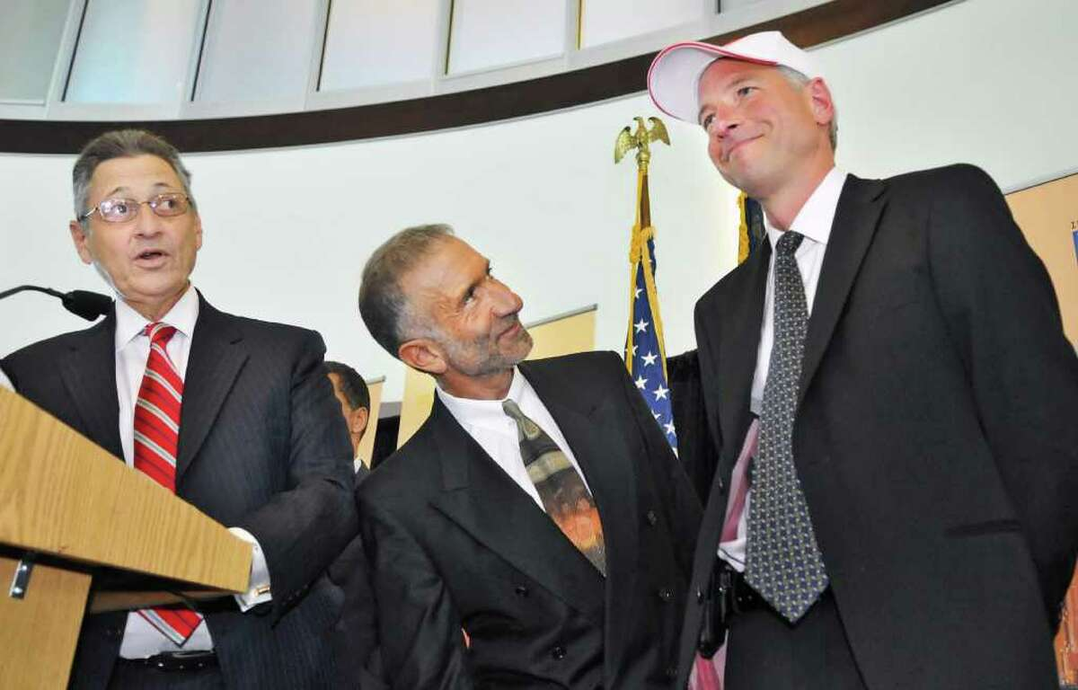 From left, State Assembly Speaker Sheldon Silver and College of Nanoscience and Engineering Senior Vice President and CEO Alain Kaloyeros present Sematech president and CEO Dan Armbrust with an I LOVE NY hat. (John Carl D'Annibale / Times Union)