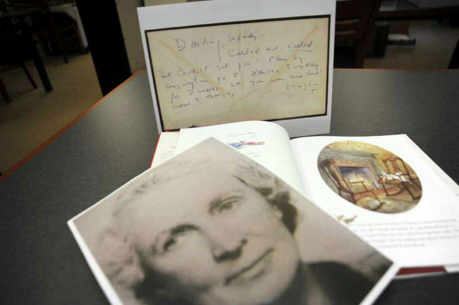 A photograph of Catherine Wood, an English teacher who taught Truman Capote at Greenwich High School, a note from Capote to Wood, and one of  Capote's books dedicated to her, at the Greenwich Historical Society, on Tuesday, Oct. 12, 2010, research for the upcoming fundraiser which will be modeled after Capote's Black and White Ball. Photo: Helen Neafsey / Greenwich Time
