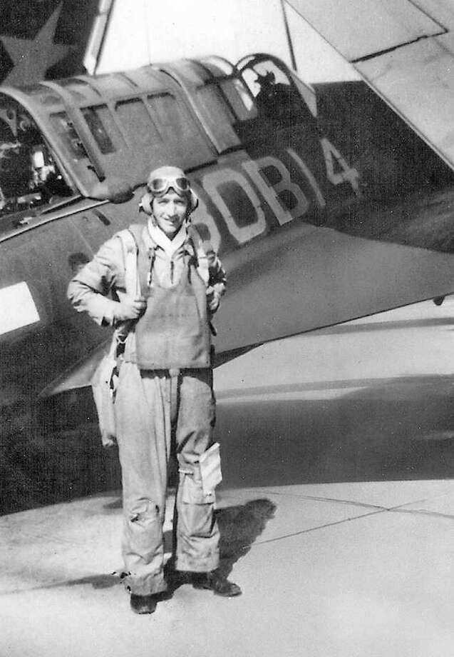 George Walsh of Darien in front of his dive bomber during WWII. Walsh says the role of dive bombers in winning the Battle of Midway has been unrecognized and is promoting research disputing the torpedo bombers' role in the victory. Photo: Contributed Photo / Stamford Advocate Contributed