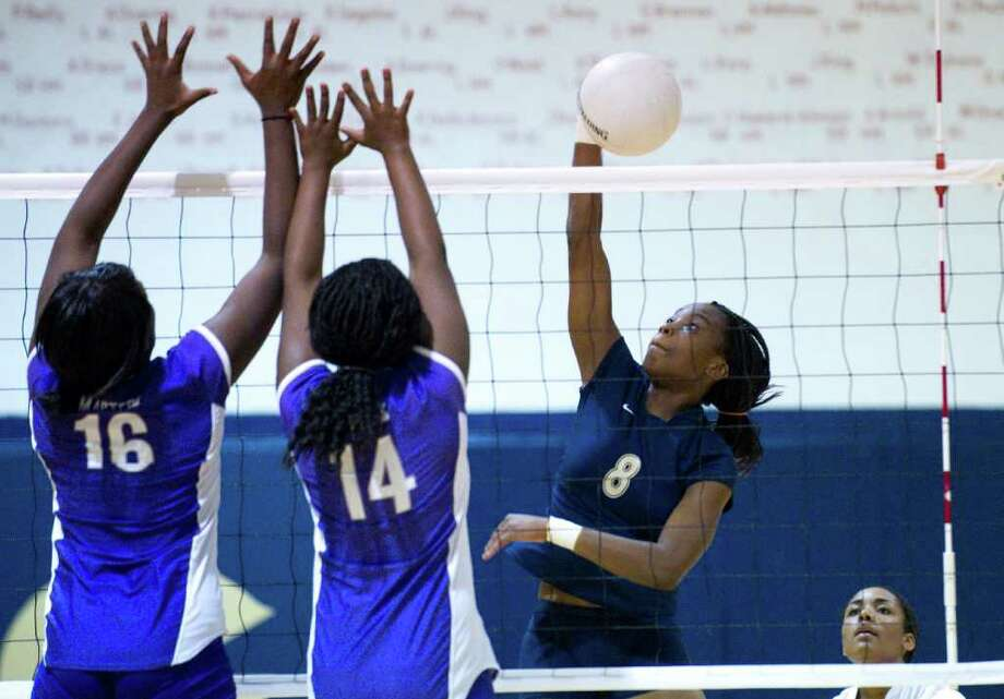 King's Dominique Carter-Stanley spikes the ball clearing Masters' defense as King school hosts Masters in a girls volleyball game Tuesday, October 12, 2010. Photo: Keelin Daly / Stamford Advocate