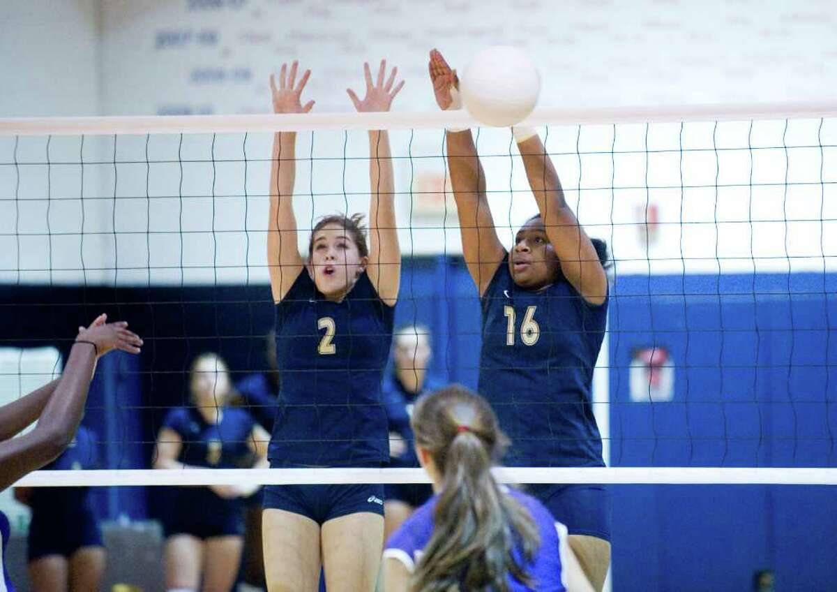 King's Lindsey Faig, left, and Tatiana Brown block as King school hosts Masters in a girls volleyball game Tuesday, October 12, 2010.