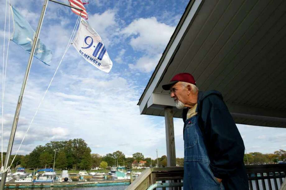 Harbormaster Bill Kovacs looks out over the Cummings Park Boat Club Marina Tuesday, October 12, 2010. Club members are upset that the city has not done maintenance on their facility and the surrounding park, which they say has caused safety hazardous and discourages prospective members from joining. Photo: Keelin Daly / Stamford Advocate