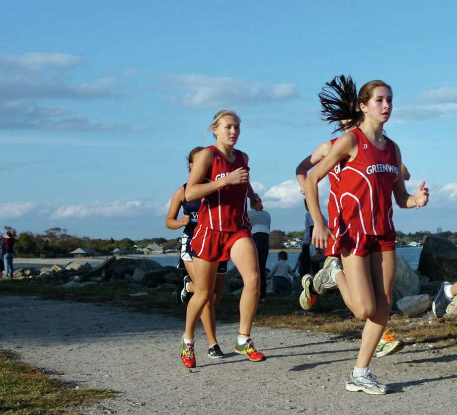 Greenwich High School cross country runners, Camille Matonis, left, and Sarah Fountain, right, during meet at Greenwich Point, Tuesday afternoon, Oct. 12th, 2010.  Matonis won the race with a time of 16:39. Photo: Bob Luckey / Greenwich Time