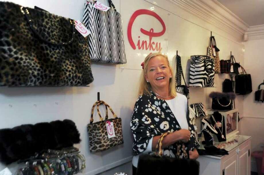 Nancy Waesche stands in her new handbag shop, Pinky, in Greenwich, on Monday, Oct. 4, 2010. Photo: Helen Neafsey / Greenwich Time