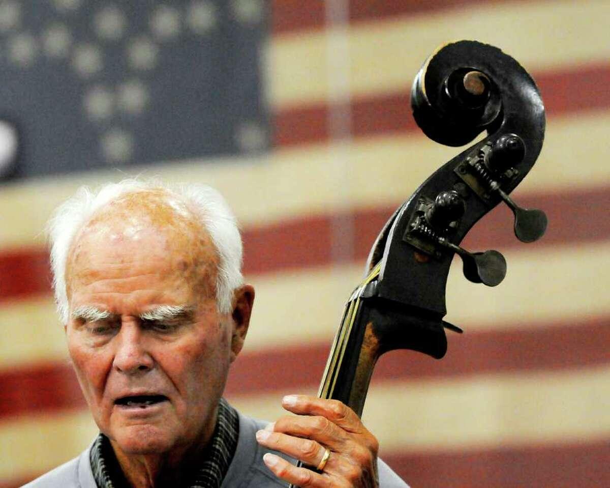 Jack Elliott, 88, of Delmar, plays the string bass. (Luanne M. Ferris / Times Union)