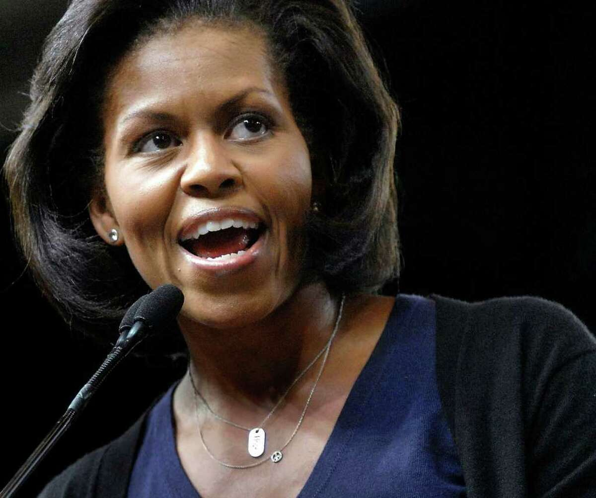 In this Oct. 13, 2008, file photo Michelle Obama, wife of Democratic presidential candidate Sen. Barack Obama, D-Ill., speaks to supporters during a rally at Macalester College in St. Paul, Minn. Not seen on the stump since the 2008 campaign that elevated her husband to the White House, Mrs. Obama is venturing out this week to support a group of candidates, mostly senators, whose help President Barack Obama needs to keep advancing his agenda through Congress in the two years left in his term. On Monday, she's scheduled to appear at Stamford's Palace Theatre for a fundraiser for Senate candidate Richard Blumenthal. (AP/Photo Craig Lassig, File)