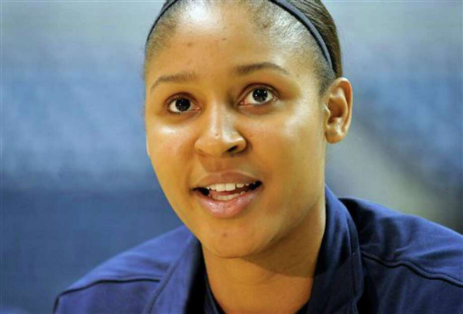 Connecticut's Maya Moore is interviewed during team's NCAA college basketball media day in Storrs, Conn., Wednesday, Oct. 13, 2010. (AP Photo/Jessica Hill) Photo: Jessica Hill, AP