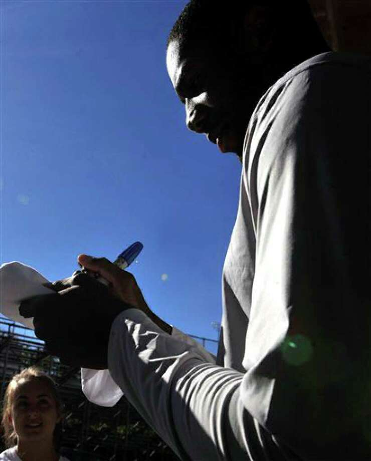 Connecticut basketball player  Alex Oriakhi signs autographs after the Husky Run during the team's media day in Storrs, Conn., Wednesday, Oct. 13, 2010.   (AP Photo/Jessica Hill) Photo: Jessica Hill, AP