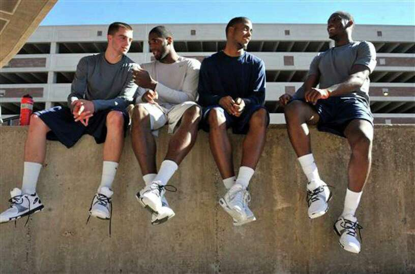 Connecticut basketball players, from left, Kyle Bailey,, Alex Oriakhi, Jamal Coombs-McDaniel and Don